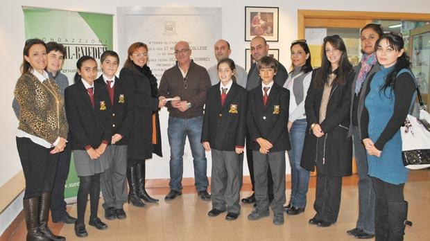 Members of the Parents' Forum of St Martin's College donating the sum of €2,000 to Fondazzjoni Suret il-Bniedem at the school in Swatar.