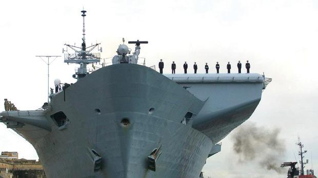 Front view of the HMS Illustrious with the Maltese contingent on the ski-ramp. Photo: Royal Navy Photographic Unit