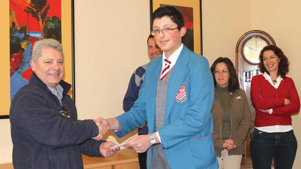 Fr Vince Magri receiving a donation from Mark Ciantar, vice-president of St Aloysius' College Students Council.