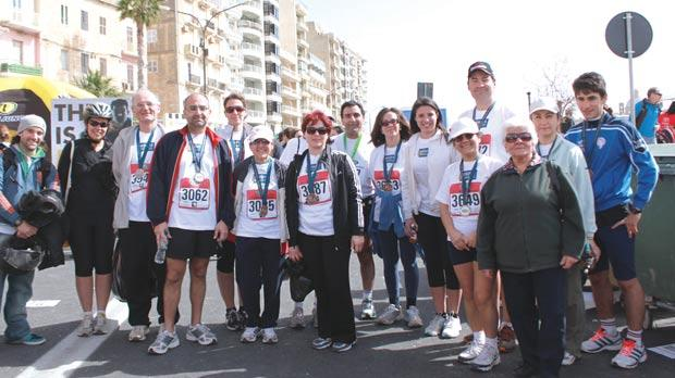 Members of the Jesuits and Friends team on completing the Land Rover Malta Marathon 2013.