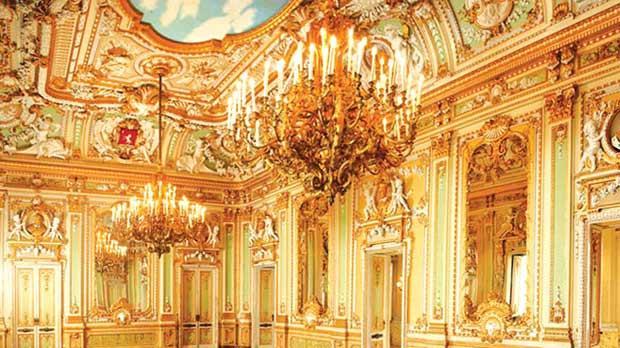 The ballroom's gilded opulence.