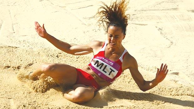 Leap of faith... Rebecca Camilleri taking part in the long jump during the European Games in Baku. She finished second in her event.