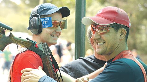 William Chetcuti (right) hugs Gianluca Chetcuti at the end of the Double Trap final at the Bidnija ranges. Photo: Matthew Mirabelli