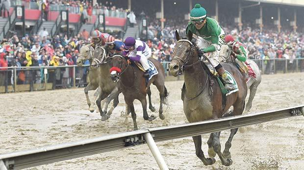 Exaggerator (right) on its way to winning the 141st running of the Preakness Stakes at Pimlico Race Course.