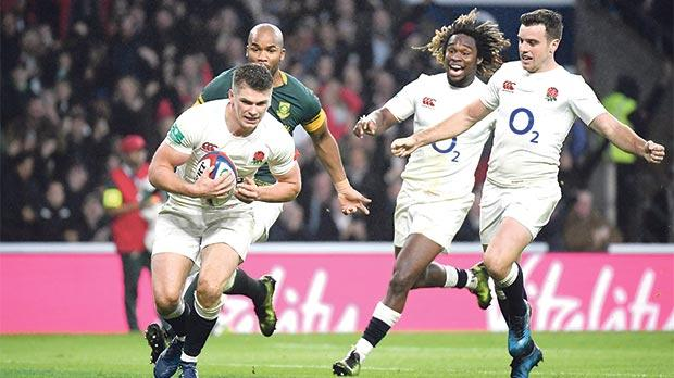 Owen Farrell runs in to score a try for England against South Africa at Twickenham.