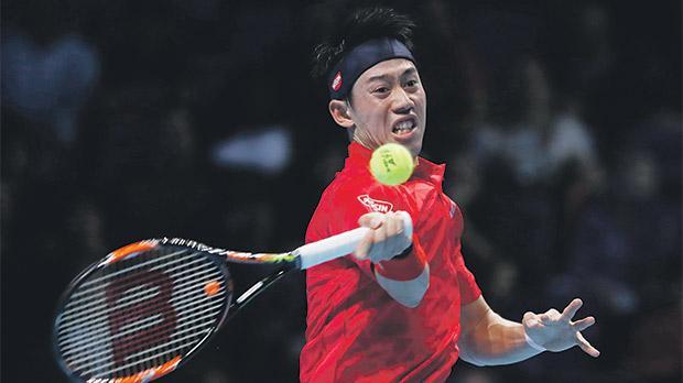 Kei Nishikori hits a shot against Stan Wawrinka at the ATPWorld Finals, yesterday.