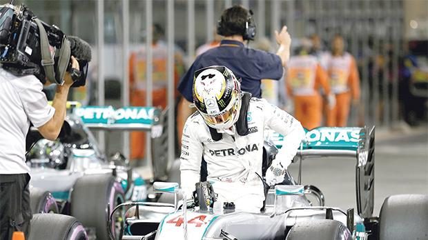 Lewis Hamilton exiting his Mercedes at the end of Sunday's grand prix in Abu Dhabi.