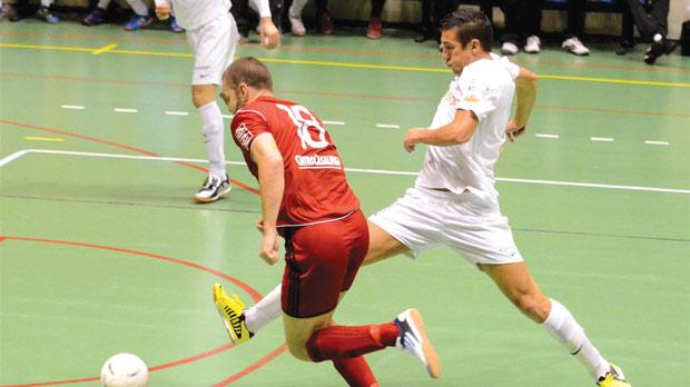 Valletta's William Barbosa (right) makes a challenge on Ħamrun's Lyubomir Vitanov. Photo: Joe Borg