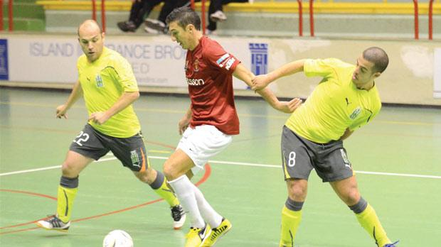 Valletta's William Barbosa forces his way through against Floriana. Photo: Joe Borg