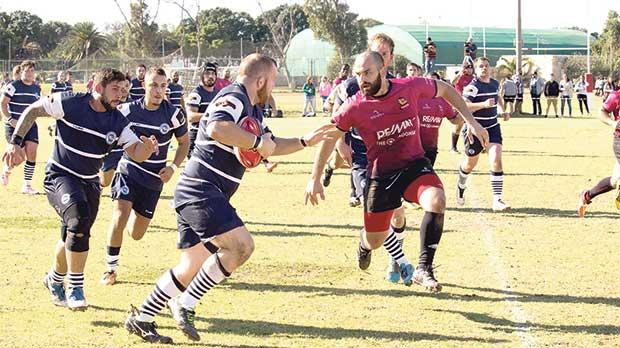 Action from the league match between Stompers and Overseas, at Marsa. Photo: Ian Stilon