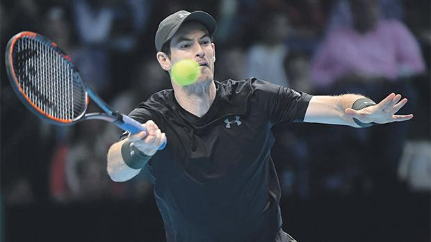 Britain's Andy Murray hits a return against Milos Raonic at the O2 Arena yesterday.