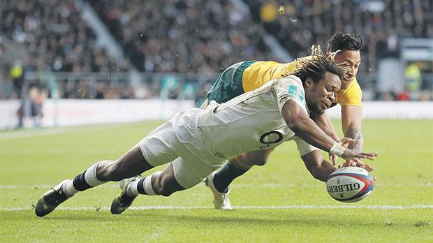 Marland Yarde touches the ball down to score a try for England against Australia, yesterday.