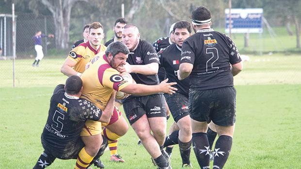 Kavallieri intercept a Falcons attack during the league match at Marsa. Photo: Ian Stilon