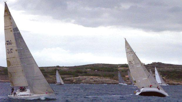 IIG Bank Gozo race boats navigating their way during competition.