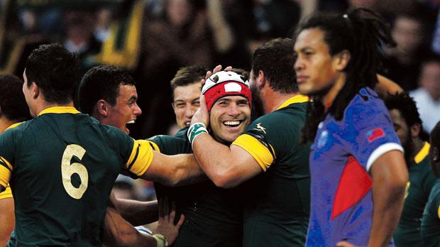 Schalk Brits (centre) celebrates after a try for South Africa against Samoa.