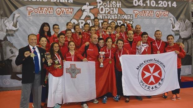 The Malta Karate Federation group proudly displaying their trophies.