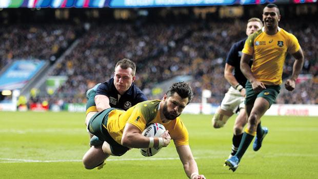 Australia's Adam Ashley-Cooper scores a try against Scotland, yesterday.