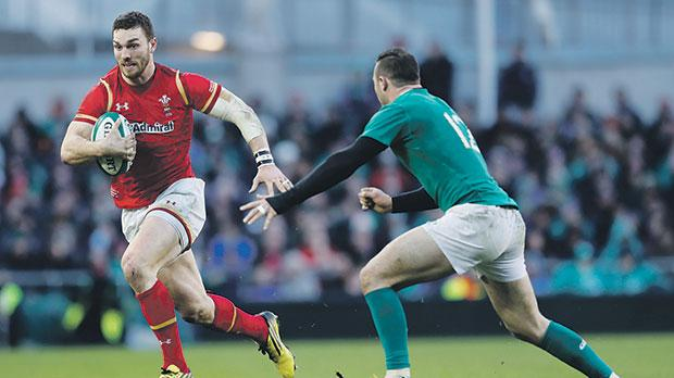 Wales player George North (left) runs past Robbie Henshaw, of Ireland, in Dublin yesterday.
