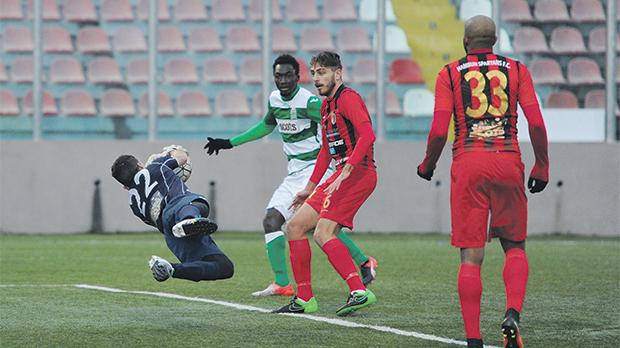 Ħamrun goalkeeper effects a save against Floriana at the Tedesco Stadium. Photo: Steve Zammit Lupi