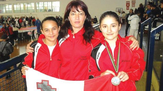 Sensei Michelle Vella flanked by Michela Rapa and Rebecca Spiteri.