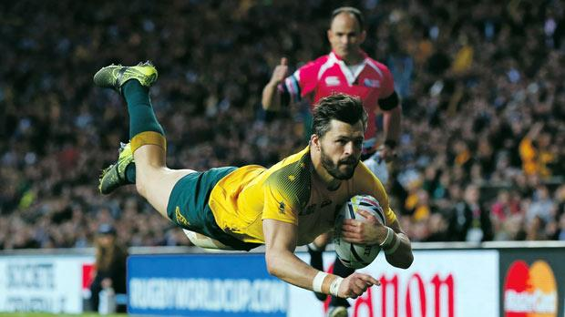 Adam Ashley-Cooper scores one of his three tries against Argentina at Twickenham.