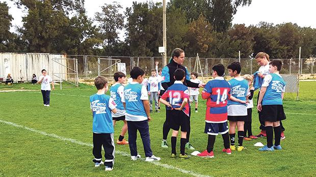 Young rugby hopefuls receiving a word of advice from one of their coaches during training at the Marsa rugby ground.­