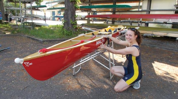 A Leipzig Rowing Club member taking a look at the boat named 'Malta'.