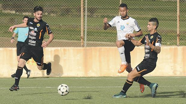 Għajnsielem captain Ferdinando Apap (right) makes a tackle on Nadur's Claudio Antunes. Photo: Anthony Cassar
