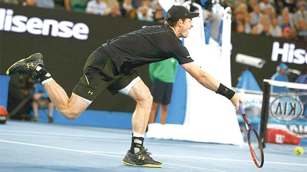 Andy Murray stretchesto reach the ball against Andrey Rublev.