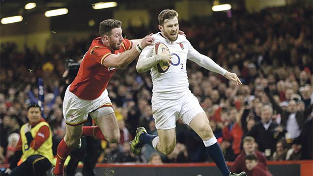 Elliot Daly (right) scores England's winning try against Wales.