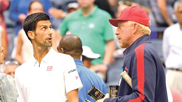 Novak Djokovic (left) on court with coach Boris Becker.