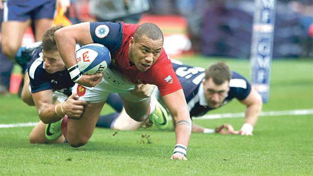 France's Gael Fickou scores a try against Scotland, yesterday.