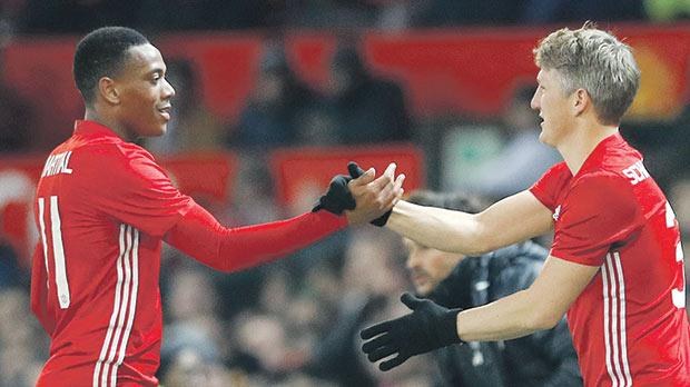 Back from the cold... Bastian Schweinsteiger (right) replaces Anthony Martial during the League Cup game against West Ham United.