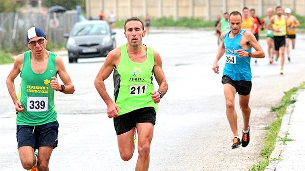 Mario Grech (left) and Charlton Debono lead the way during the Ta' Qali 10K as Andrew Grech follows closely behind. Photo: Wally Galea