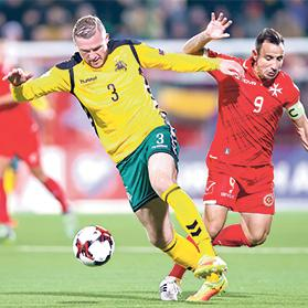 Georgas Freidgeimas (no.3), of Lithuania, beats Michael Mifsud to the ball. Photos: Paul Zammit Cutajar