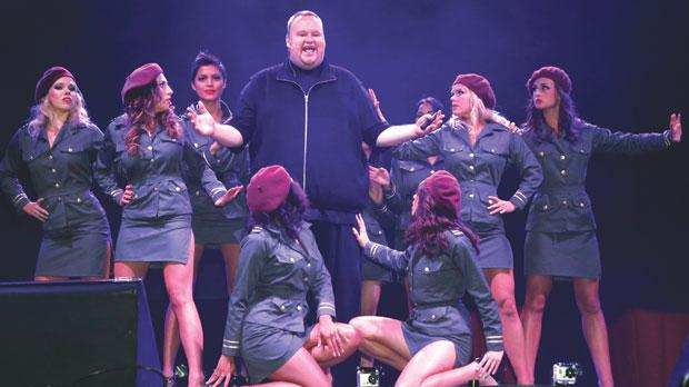 Megaupload founder Kim Dotcom launching his new file-sharing site Mega, surrounded by dancers, in Auckland, on Sunday. Photo: Reuters