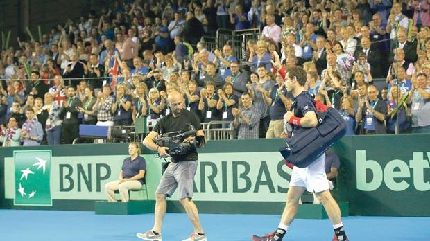 Fans applaud Andy Murray as he walks off the court during Britain's semi-final against Argentina.