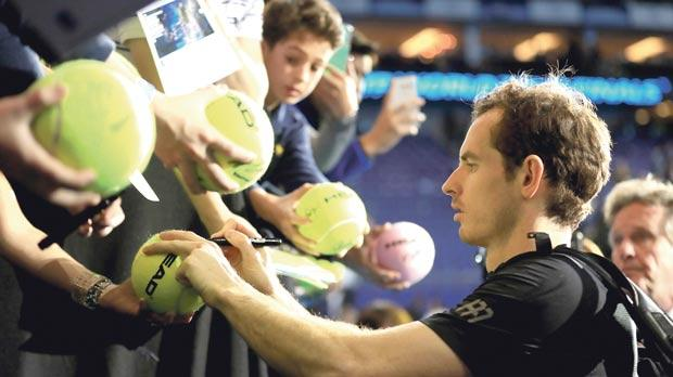 Andy Murray signing match souvenirs for fans, yesterday.