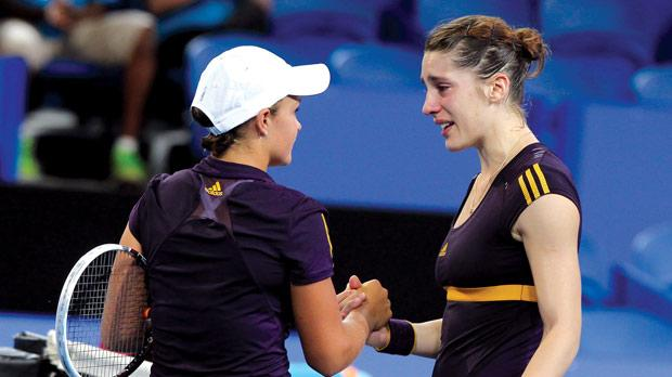 A tearful Andrea Petkovic (right) shakes hands with Ashleigh Barty in Perth yesterday.