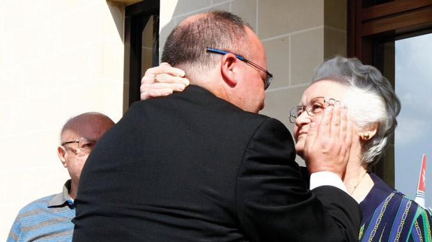 The first person he told about his appointment as Auxiliary Bishop was his mother. Here he is warmly holding her face on his arrival from Rome when the news broke.