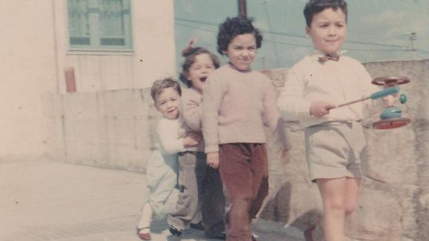 Leading the way... A young Charles leads his siblings as they play on the roof of their Qormi roof circa 1967.