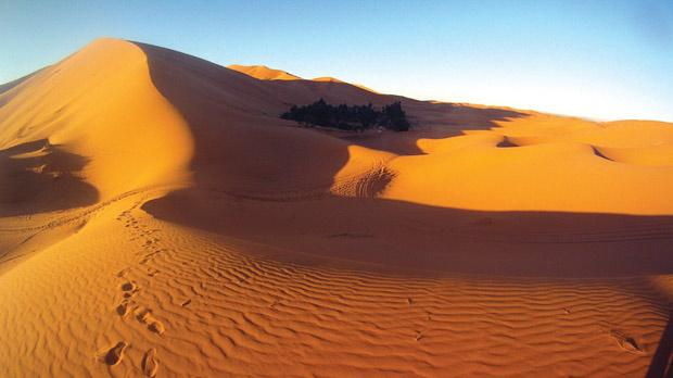 Shifting, orange sand stretches off in every direction, piling up 350 metres high in some places.