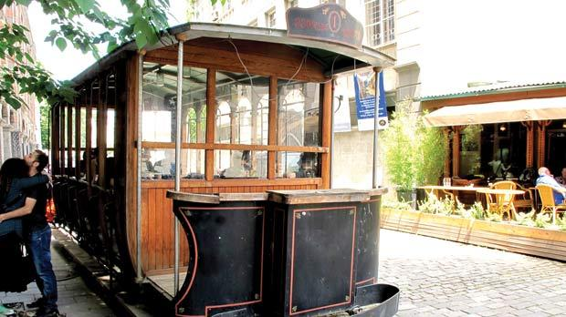 An old tram car in Tbilisi offers a unique venue for picnics and dates.