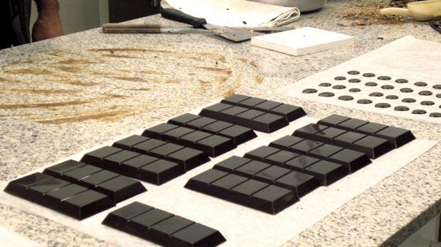 Modica's chocolate before being packaged. The chocolate is available in various flavours including vanilla, cinnamon, lemon, orange, peperoncino and even salted.