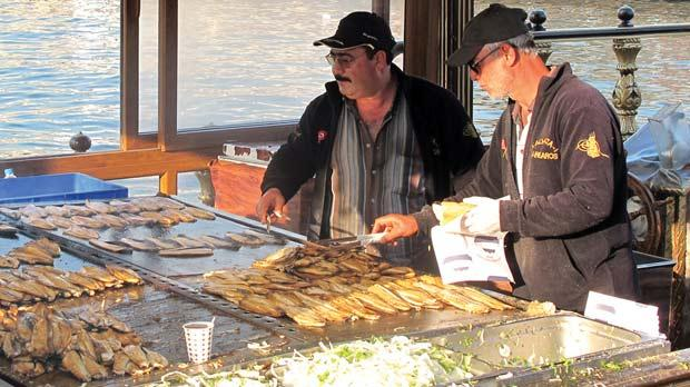 The preparation of fish sandwiches on uncovered grills releases an unmistakable smell into the sea air.