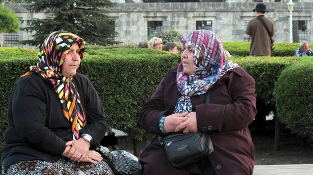 Two old women gossip near the Blue Mosque.