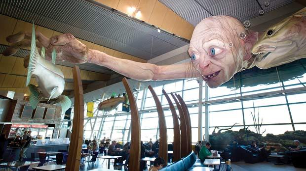A sculpture of a giant Gollum from The Hobbit film catching a fish on the ceiling of Wellington Airport, New Zealand.