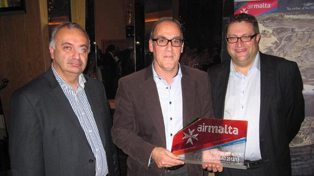 Noel Farrugia, director of Brittania Services Ltd (centre), receiving the Top Travel Agent award from Philip Saunders, Air Malta's chief commercial officer (right), and Charles Cilia, head of sales and regions.