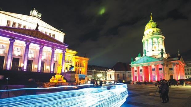 The Concert Hall and French Dome lit by colourful lights,
