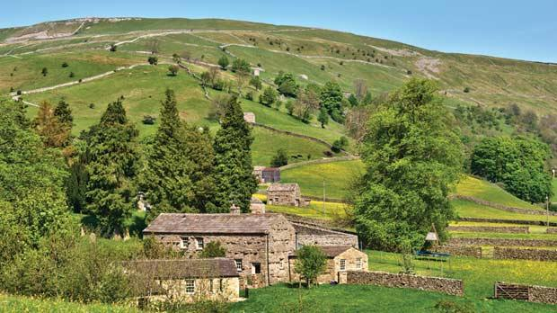 A farmhouse in the rolling hills of the Yorkshire Dales.